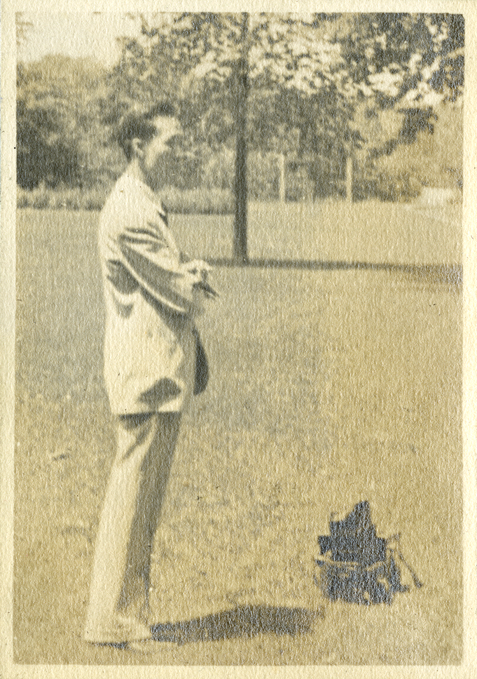 Onn Mann Liang taking an outdoors photograph, 1930
