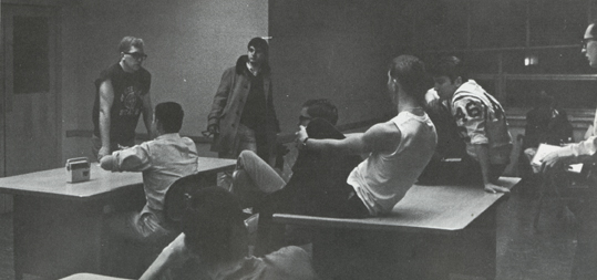 Group of young men meet in dormitory, 1966-1967