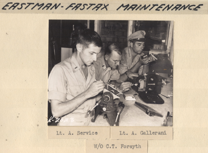Men perform camera maintenance on Eastman Fastex cameras, 1945-1946