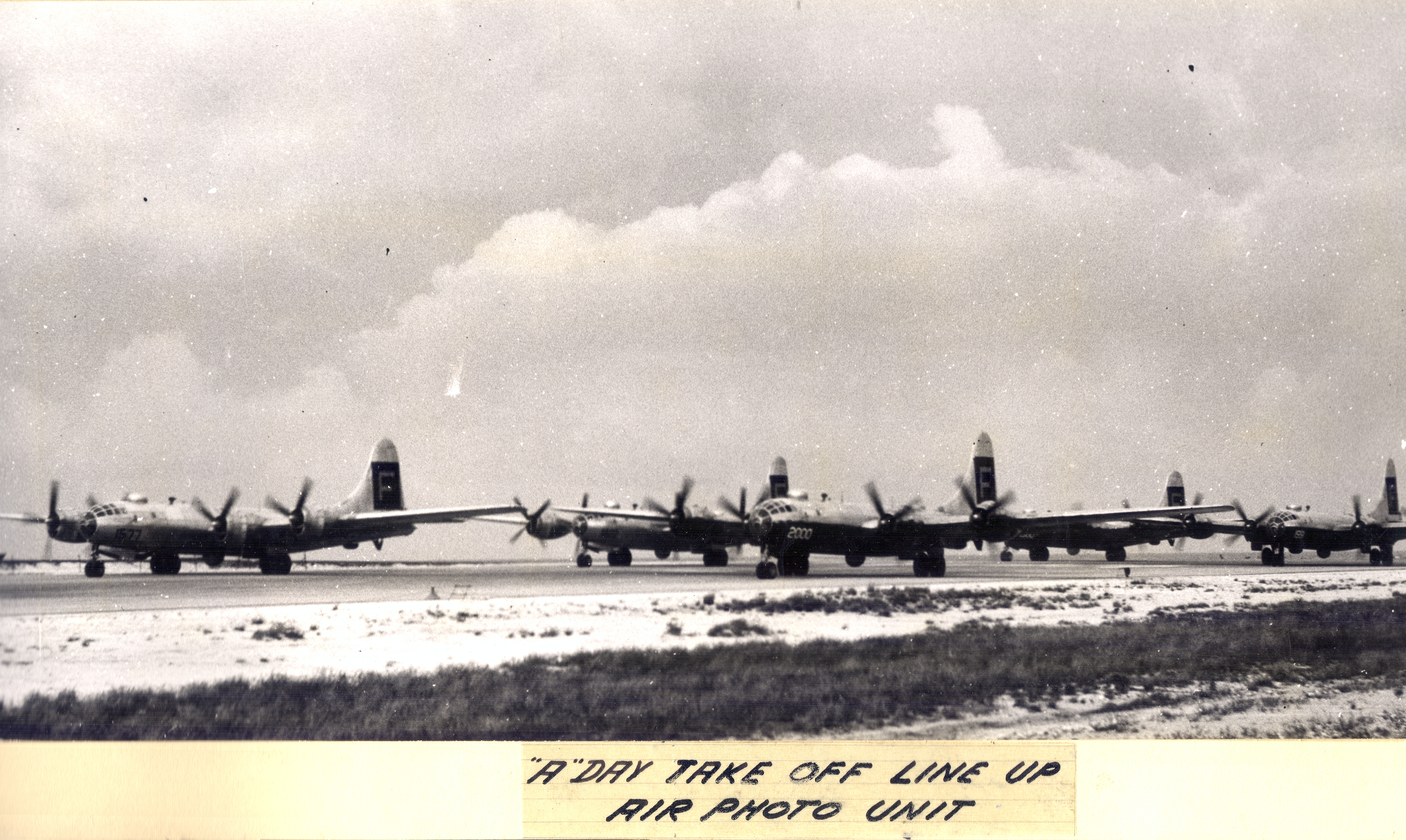 Planes line up to record the first atomic test at Bikini Atoll, 1945-1946