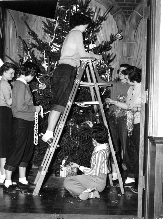 Student decorate their dormitory Christmas tree in 1948