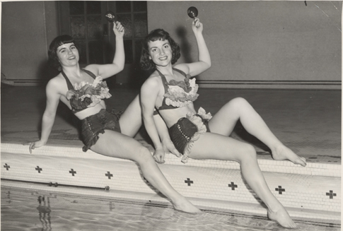Two swimmers pose in costume