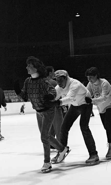 3 Students Skating at Munn Arena