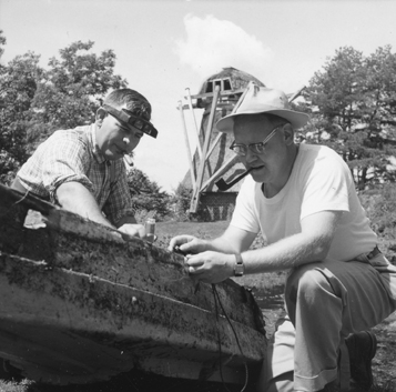 Faculty working in a field at Kellogg Biological Station, 1959