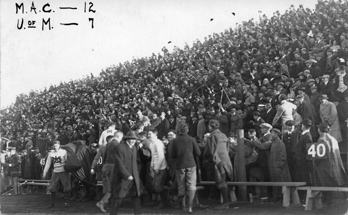 Fans at a M.A.C. vs. University of Michigan football game