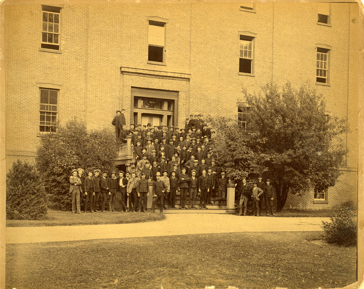 Group of students on the steps of a building, 1885-1886