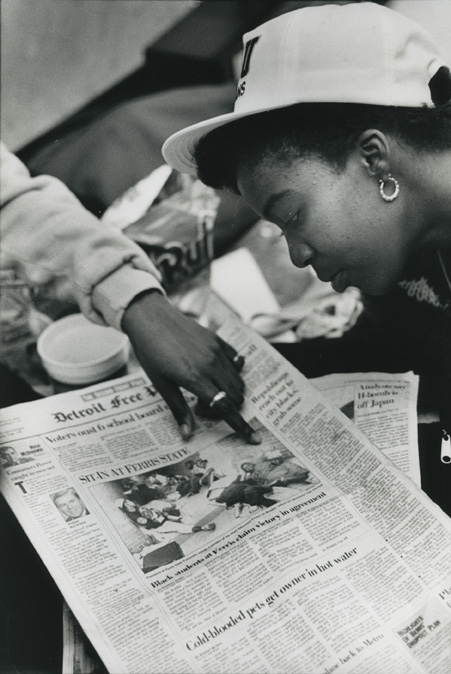 Female student looks at a newspaper during the 1989 student occupation of the Hannah Building