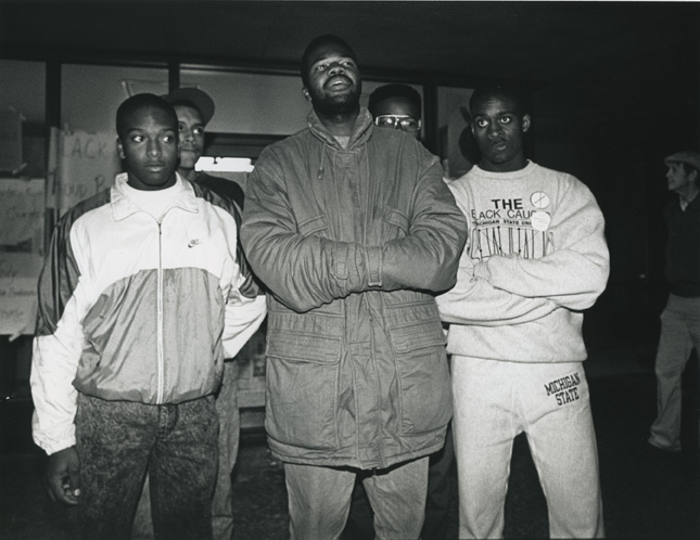 Five students stand in front of the doors of the Hannah Building during the 1989 student occupation