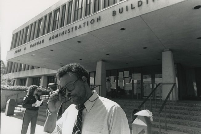 Man walks away from the Hannah Building during the 1989 student occupation