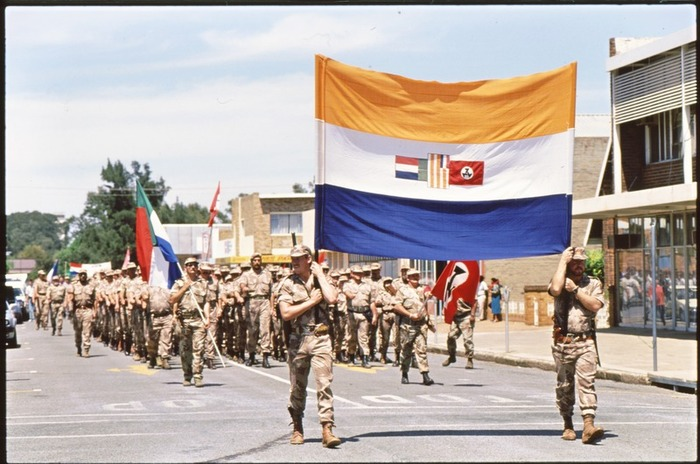 Storm troopers of the Afrikaners Weerstandsbeweging (Afrikaner Resistance Movement) carrying the South African flag during a right-wing rally in Klerksdorp in 1993.
