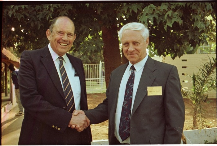 Generals Magnus Malan and Constand Viljoen shaking hands at a meeting in September 1997.