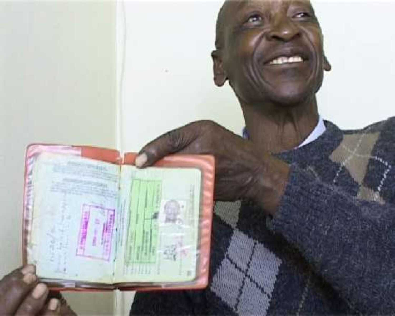 Isaac Malome Masike, a semi-retired small business man from Rammolutsi, shows his old pass book during an oral history interview with Dale McKinley and Ahmed Veriava.
