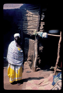 Old woman standing in village house, grandmother of Aggie