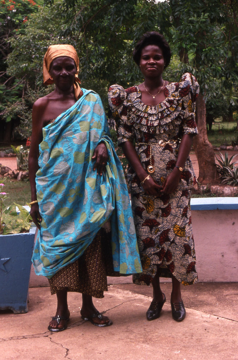 Cloth trader and daughter helper standing dressed up