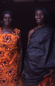 Two older women standing in funeral cloth