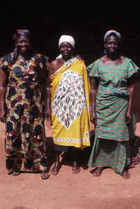 Three standing women in cloth