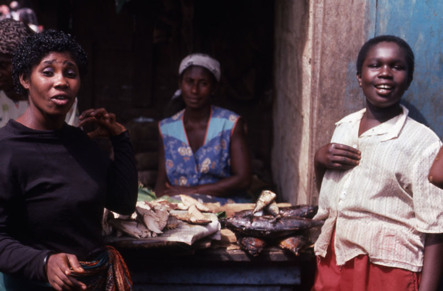 Three standing women in fish stall