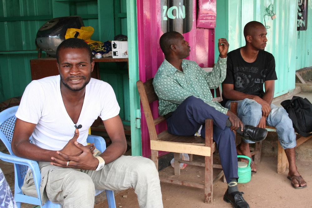 Men Outside their Kiosks