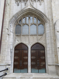 Windows above the bell tower doors, exterior view