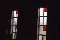 Translucent windows with red panes and candles