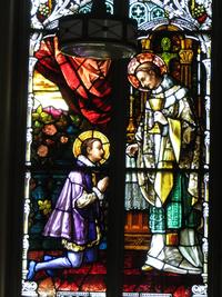 St. Borromeo gives Communion to St. Aloysius